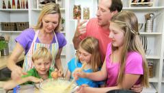 Blonde Caucasian Mom Teaching Family Cake Baking - stock footage