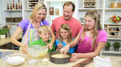 Happy Blonde Caucasian Family Home Kitchen Baking Together - stock footage
