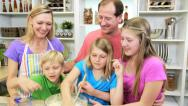 Stock Video Footage of Family Group Blonde Caucasian Parents Children Homemade Baking