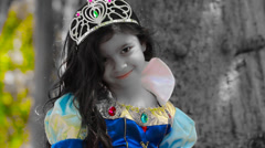 Little girl Snow White Fairy tale sitting next to old tree Stock Footage