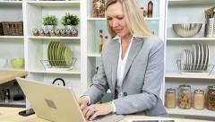 Female Blonde Caucasian Business Advisor Working Home - stock footage