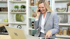 Blonde Caucasian Businesswoman Working Home Smart Phone Laptop Stock Footage