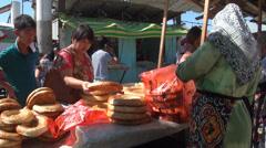 Buying bread at Osh bazaar Stock Footage