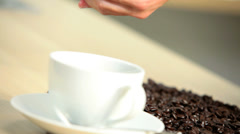 Stock Video Footage of Whole Coffee Beans Female Caucasian Hands Close Up