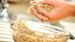 Female Hands Close Up Bowl Dry Cereal Grains - stock footage