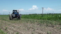 Spraying pesticide in a field near Osh, Kyrgyzstan Stock Footage