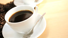 Fresh Coffee Beans Pouring Onto White Table Female Hands - stock footage