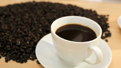 Stock Video Footage of Whole Coffee Beans Cup Hot Coffee Close Up