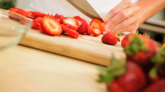 Close Up Female Hands Slicing Fresh Organic Strawberries Stock Footage