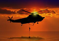 Rescue helicopter at sea Stock Illustration