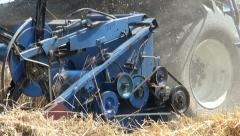 Closeup of the wheels and blades of a combine harvester Stock Footage