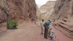 People in a desert slot canyon Stock Footage