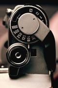 Old film camera detail of the trigger and shutter speed control Stock Photos