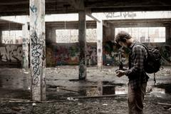 Photographer taking pictures of an abandonned building Stock Photos