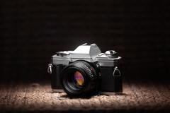 Old 35mm film camera under a spot light Stock Photos