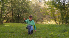 Boy dancing, somersaults, jumping on the grass Stock Footage