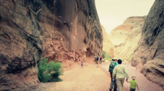 People in a cool desert slot canyon Stock Footage