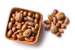 Various unpeeled nuts in wooden bowl Stock Photos
