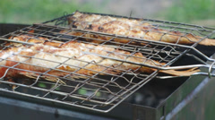 Rock Fish on the grill with flames . - stock footage