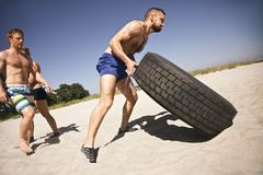 Stock Photo of tough crossfit workout on beach