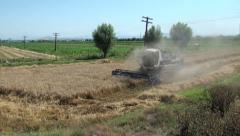 Combine harvester, small field, Kyrgyzstan Stock Footage