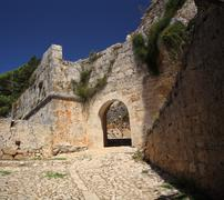 archway at ayios georgios castle - stock photo