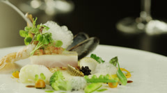 Eating Delicious Dish with Fish Filet and Oysters. 4K Stock Footage
