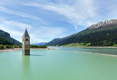 the bell tower in reschensee (italy). - stock photo