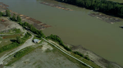 Aerial view of log boom Fraser River, Vancouver - stock footage
