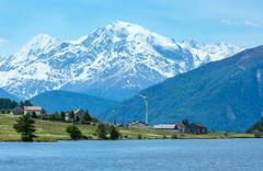 summer reschensee alpine view (italy). - stock photo