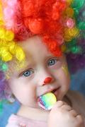 clown baby with sucker - stock photo
