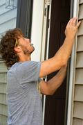 Carpenter fixing door Stock Photos