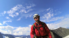 Male mountain Peak climber filming selfie while ridge trekking  Alaska, USA Stock Footage