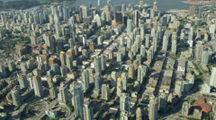 Aerial view over Vancouver City Harbour Downtown skyscrapers Stock Footage
