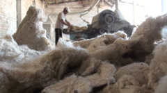 Silhouette of a worker behind dirty cotton Stock Footage