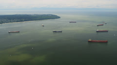 Aerial view of Container Ships and Bulk Carriers, Vancouver - stock footage