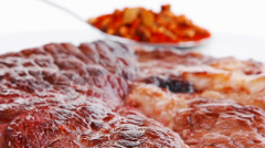 meat food : roasted steak on white plate with red chili pepper a - stock footage