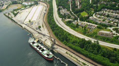 Aerial overhead view bulk carrier loading freight, Vancouver Stock Footage
