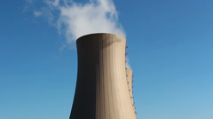 Cooling towers of nuclear power plant against  blue sky Stock Footage