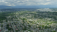 Aerial view residential suburbs New Westminster, Vancouver - stock footage