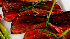 Meat and vegetables on white plate Stock Footage