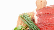 Stock Video Footage of fresh raw red meat with thyme and chives