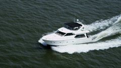 Aerial view luxury seafaring motor cruiser at speed - stock footage