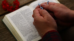 Hands with Bible and rosary episode 3 - stock footage