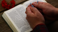 Stock Video Footage of Hands with Bible and rosary episode 3