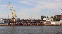 Harbor cranes, shipyard - Szczecin, Poland Stock Footage