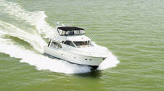 Aerial view luxury motor cruiser at speed - stock footage