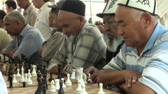 Old muslim men are playing chess Stock Footage