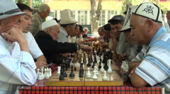 Senior Kyrgyz men are playing chess, activity in the park, Central Asia Stock Footage