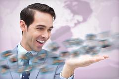 Cheerful businessman admiring a picture whirl - stock photo